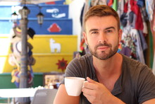 Handsome Man Enjoying A Cup Of...