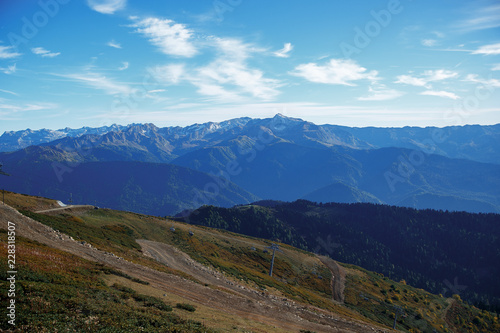 Mountain landscape in the afternoon, rocks in the background