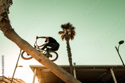 Young man with a bmx bike around the city. BMX freestyle