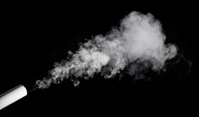 Smoke From A Pipe On A Black Background