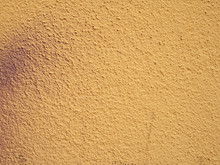 A Pale Grainy Textured Yellow ...