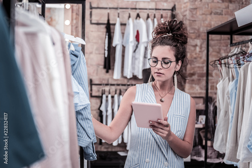 New Collection Young And Successful Fashion Designer Looking At Photos On Her Tablet Working On New Collection Buy This Stock Photo And Explore Similar Images At Adobe Stock Adobe Stock