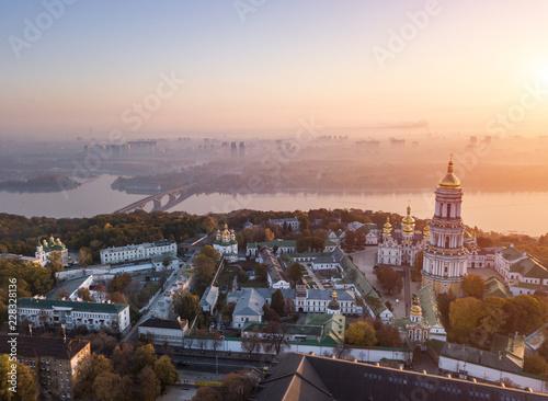 Kiyv Ukrainian capital city. Kiev Pechersk Lavra. Aerial drone photo. View to rider Dnipro and bridge. Fog and sunrise light. Amazing view.