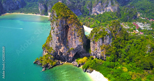 Fotobehang Tropical strand Isolated Tropical Islands With Lush Greenery Surrounded by Turquoise Ocean Water with Boats Moored Off Coast - Aerial Overhead View - Thailand