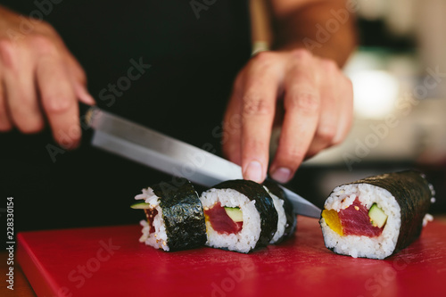 Man cutting fresh sushi