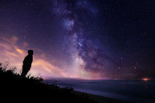 Silhouette Of A Lonely Man Watching The Stars And The Milky Way Over The Sea In Tuscany