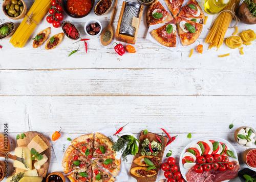Various kind of italian food served on wood