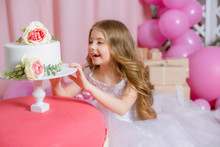 Little Girl With Blond Long Hair Celebrate Happy Birthday Party With Rose Decor, Balloons And Cake