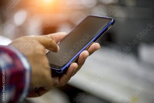 Fototapeta Hands using smartphone, Internet of things concept, World wide technology obraz na płótnie