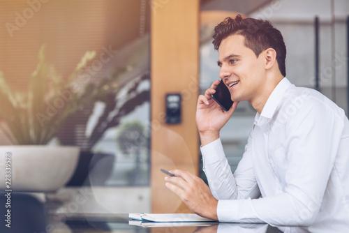 Obraz Businessman is talking on phone - fototapety do salonu