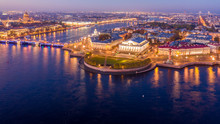 Aerial View Vasilievsky Island With Rostral Columns, Palace Bridge Or Dvortsovy Bridge, And Saint Isaac Cathedral Across Moyka River, St Petersburg, Russia