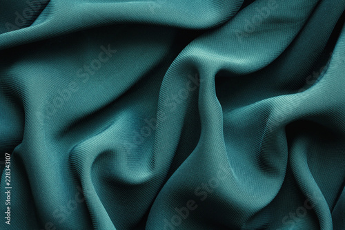 Photo sur Aluminium Tissu green fabric with large folds, abstract background