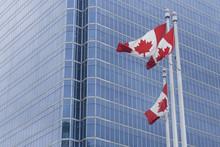 Canadian Flag Infront Of Moder...