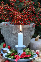 Decoration With Vintage Candle Holder, Green Wreath And Rose Hips