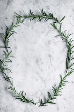 Rosemary Frame On Marble Backg...