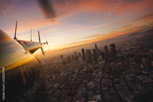 View of the city at sunset from a helicopter