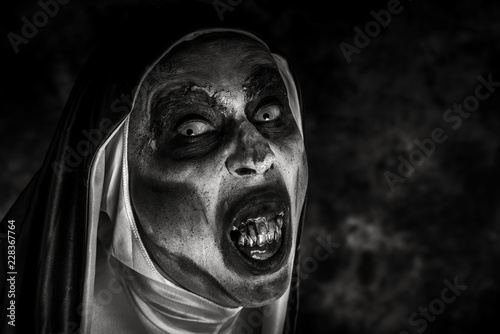 frightening evil nun with bloody teeth. Canvas Print