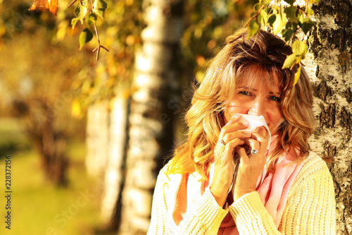 Mature woman with handkerchief and cold outdoor Fototapete