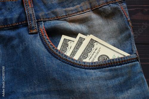 Fotografía  American money dollars in a pocket of trousers