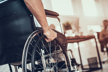 Close Up. Disabled Man On Wheelchair In Office.