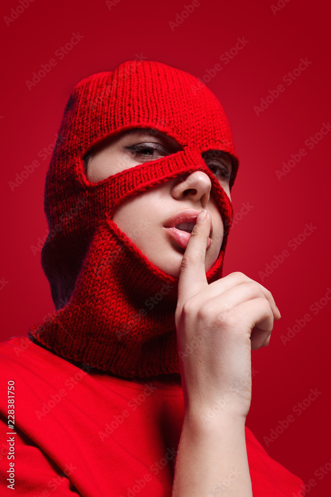 Fototapeta Woman in mask showing silence gesture