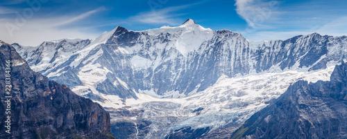 Foto auf Gartenposter Gebirge Great view of the massive rock in snow sunlight. Location Swiss alps, Grindelwald valley.