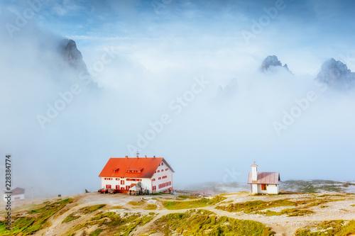 Great foggy view of the National park Tre Cime di Lavaredo. Location Dolomiti alps, Italy,