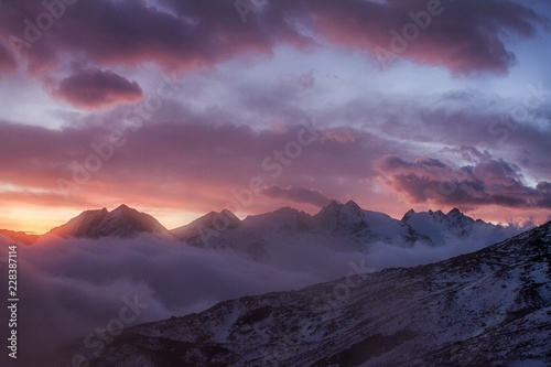 Foto auf Leinwand Aubergine lila Great view of the foggy valley in Gran Paradiso National Park, Alps, Italy, dramatic scene, beautiful world. colourful autumn morning,scenic view with cloudy sky, majestic dawn in mountain landscape