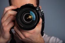 Photographer Using DSLR Camera...