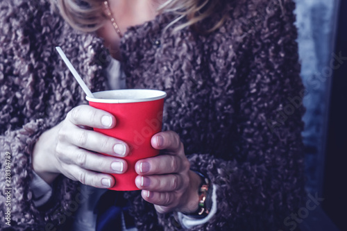 girl holding a red paper Cup of coffee Canvas Print