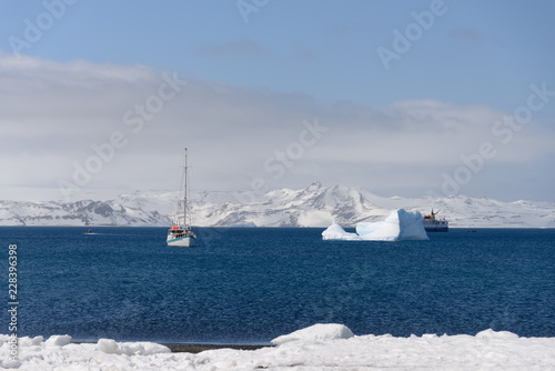 Poster Antarctica Sailing yacht and iceberg in antarctic sea
