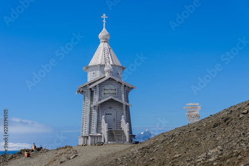 Tuinposter Antarctica Wooden church in Antarctica on Bellingshausen Russian Antarctic research station and helicopter