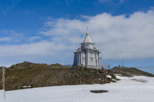 fototapeta na lodówkę Wooden church in Antarctica on Bellingshausen Russian Antarctic research station and helicopter