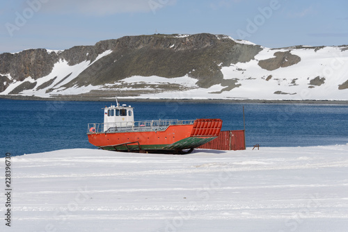 Foto op Plexiglas Antarctica Orange boat on shore near Bellingshausen Russian Antarctic research station