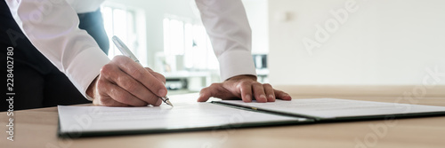 Businessman signing important document - fototapety na wymiar