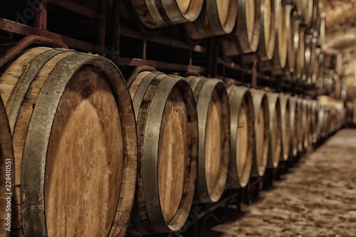 Leinwand Poster Large wooden barrels in wine cellar, closeup
