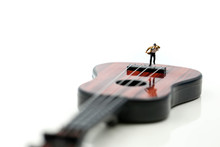 Miniature People : Businessman Standing On Acoustic Guitar. Time Of Relax Or Music Relax Concept.