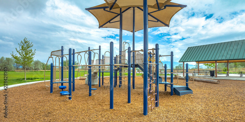 Fototapeta Childrens playground under cloudy sky in Lehi Utah