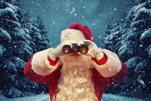 Santa Claus Looking Through Binoculars. Christmas Concept.