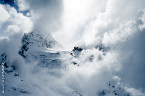 Photo sur Toile Taupe A storm in the high snowy mountains