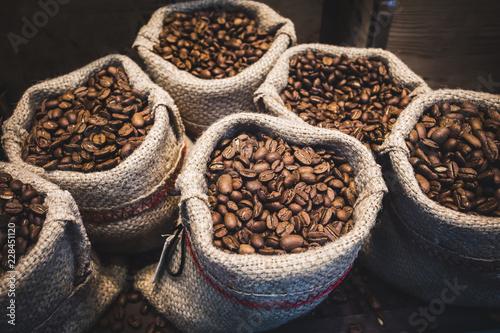 Fotobehang Koffiebonen Coffee beans in bags. Fresh coffee beans background.
