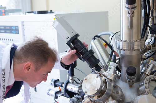 laboratory specialist examines the data obtained on a special apparatus for analyzing samples