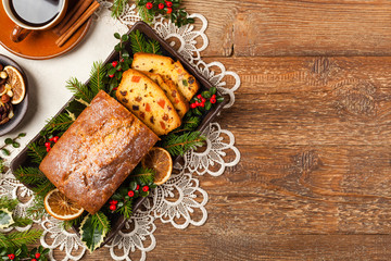 Fototapeta Christmas fruitcake. Natural wooden background.