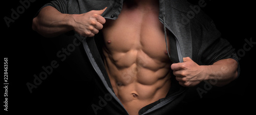 Handsome slim man with muscular body Wallpaper Mural