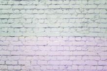Brick Wall Painted With Pale Lilac And Gray Paint. Background With Texture.