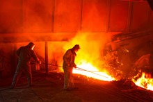 Iron Works Blast Furnace Taphole Spewing Molten Iron
