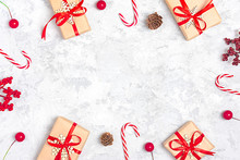 Christmas Composition. Christmas Decoration Gifts, Glitter, Christmas Balls, Candy, Snowflakes On Gray Concrete  Background. Flat Lay, Top View.