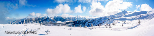 Panorama view of a sunny and fresh snow covered mountaintop in Flachau, Austria