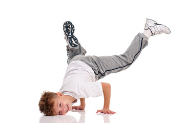 Happy little hip hop dancer - boy dancing isolated on white background. Young white b-boy dancing break dance.