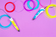 canvas print picture - 3d pens with colourful plastic filament on purple background